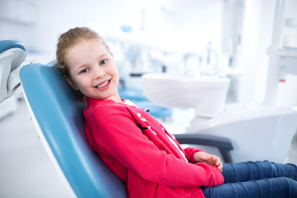 Little girl in dentist chair
